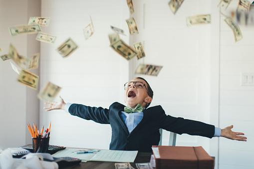 Young Boy Businessman Catching Falling Money 1093342572