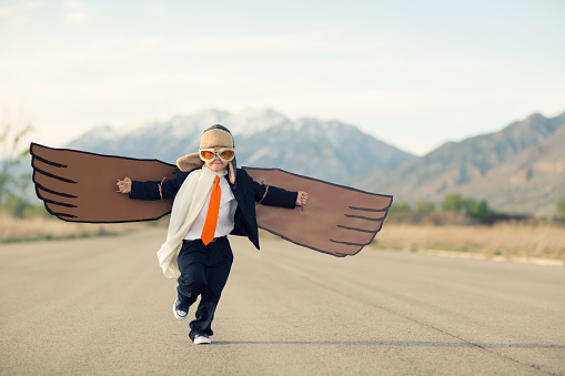 Young Boy Businessman Dressed in Suit with Cardboard Wings - gettyimageskorea