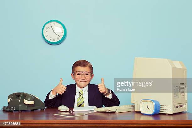 young boy businessman gives thumbs up at office - vintage stock stock pictures, royalty-free photos & images