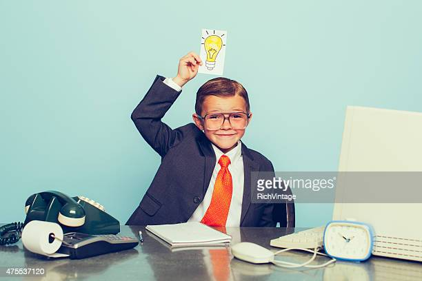 young boy businessman has big ideas - vintage stock stock pictures, royalty-free photos & images
