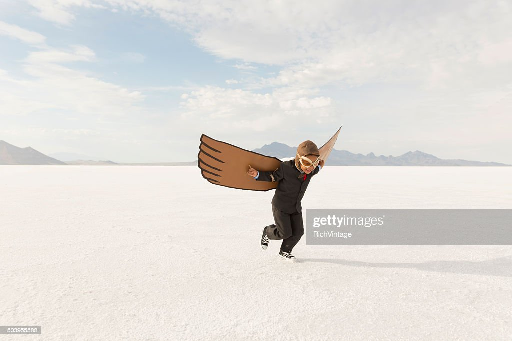 Young Boy Businessman is Flying Away : Stock Photo