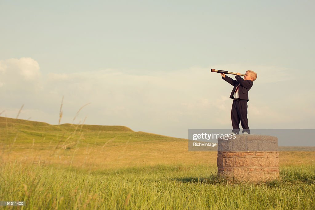 Young Boy Businessman Looking throught Telescope : Stock Photo