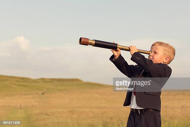 Young Boy Businessman Looking throught Telescope