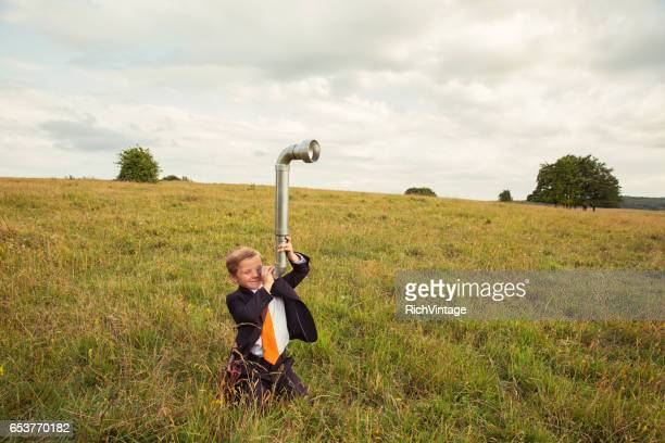 Young Boy Businessman Looks for Business with Periscope