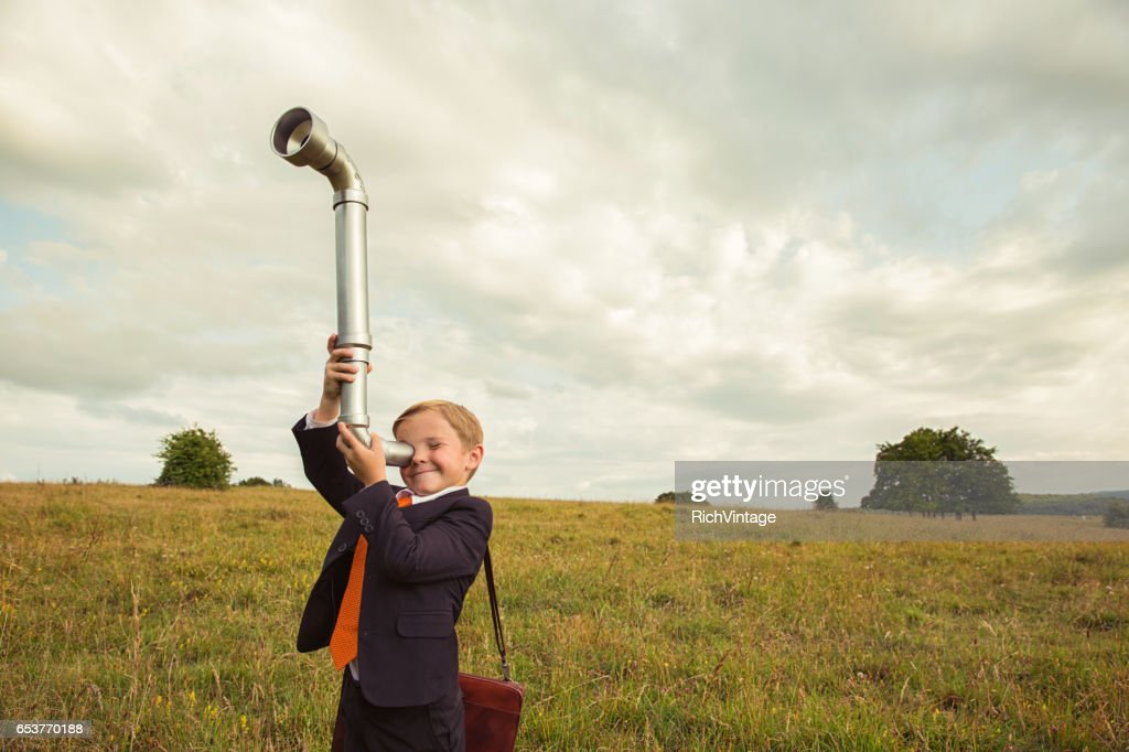 Young Boy Businessman Looks for Business with Periscope : Stock Photo