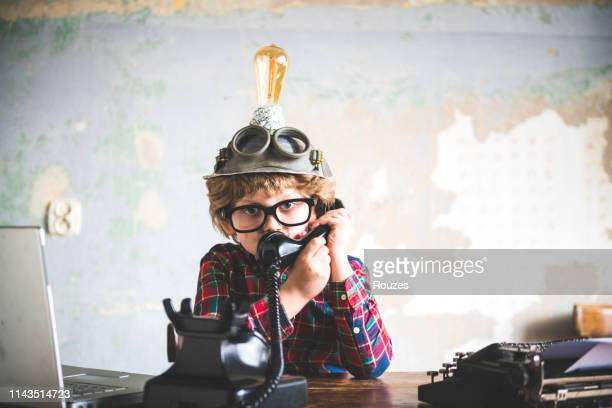 young boy businessman talks on the telephone - funny customer service stock pictures, royalty-free photos & images