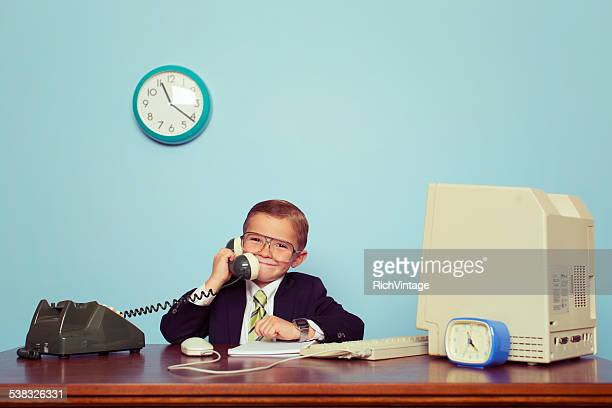 young boy businessman talks on the telephone - vintage stock stock pictures, royalty-free photos & images