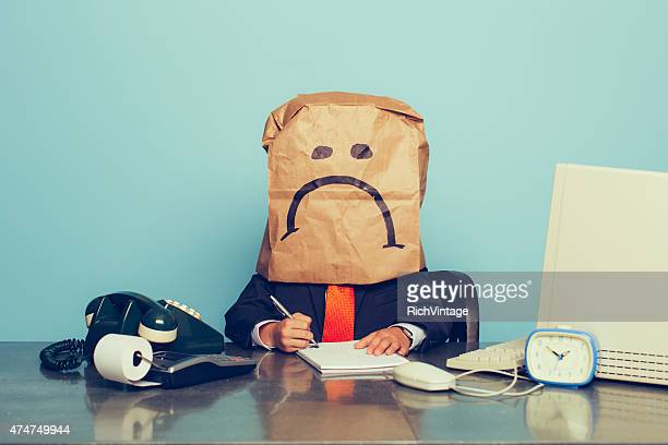young boy businessman wears sad face - negative emotion stock pictures, royalty-free photos & images