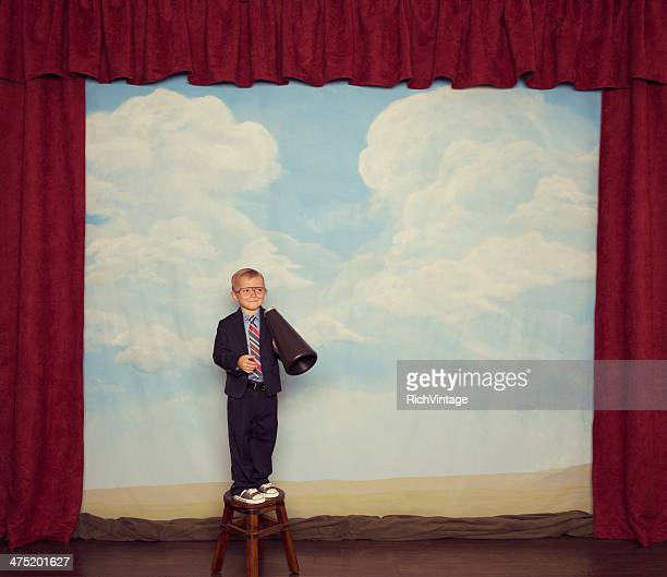 Young Boy Businessman with Megaphone on Stage