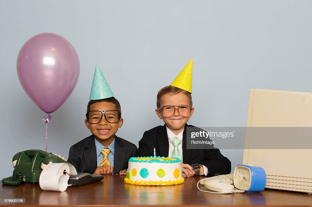 Young Boy Businessmen Celebrate with Business Birthday Cake : Stock Photo