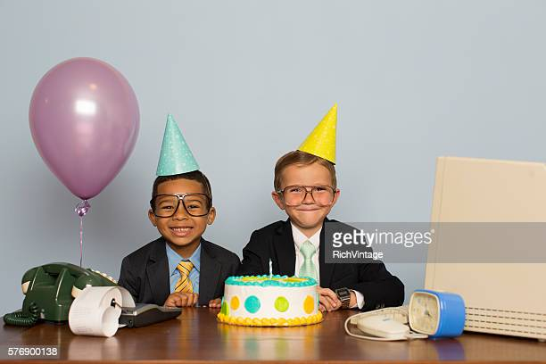 young boy businessmen celebrate with business birthday cake - jahrestag stock-fotos und bilder
