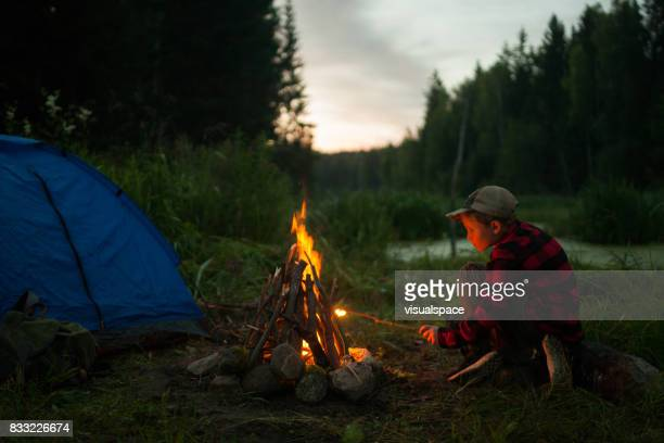 Young boy camping together