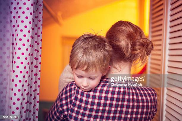 young boy carried by his mother - boys taking a shower stock pictures, royalty-free photos & images