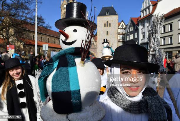 A young boy carries a small snowman during the traditional spring festival parade in Eisenach Germany 25 March 2017 This year's theme is '500 years...