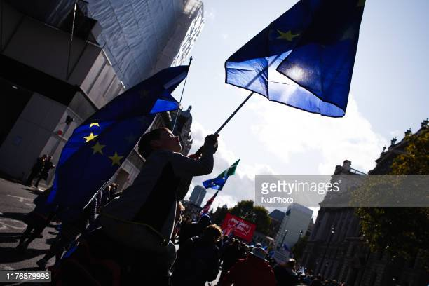 A young boy carries an EU flag along Parliament Street during the mass 'Together for the Final Say' march organised by the 'People's Vote' campaign...