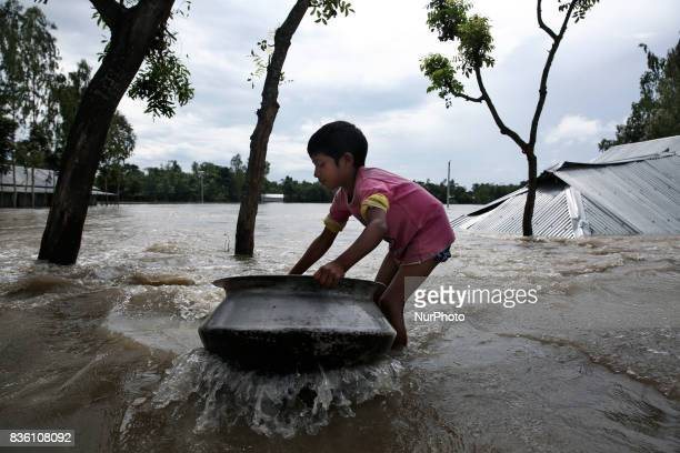 Young boy carries relief to his roadside shelter in Islampur Jamalpur Bangladesh on 19 August 2017