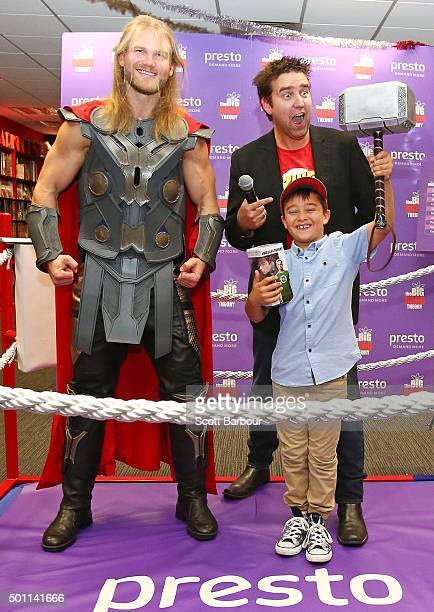 A young boy celebrates after defeating a man dressed as Thor as MC Jay Allen looks on during the First ever 'Rock Paper Scissors Lizard Spock'...