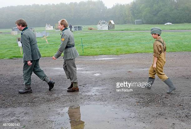 A young boy chases behind a column of German Army reenactors at the annual wartime and 1940's weekend on October 11 2014 in Pickering England The...