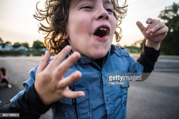 a young boy cheering. - 8 9 years photos stock photos and pictures