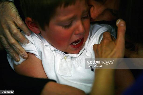 Young boy cries after receiving an immunization jab at a health centre on September 11, 2007 in Glasgow, Scotland. Medical experts still believe the...