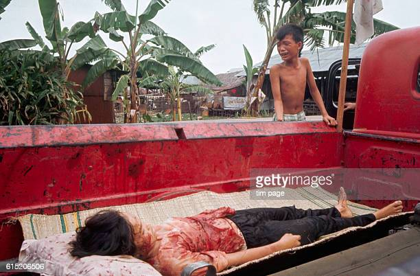 A young boy cries over the body of his 12 year old sister shot by US helicopters during the miniTet offensive near Ybridge Saigon in 1968 | Location...