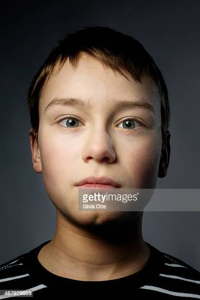 Young boy crossing his eyes