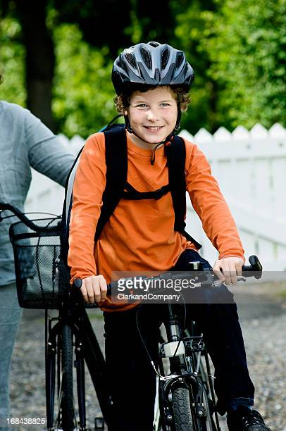 Young Boy Cycling Off To School