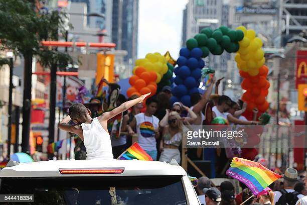 TORONTO ON JULY 3 A young boy dabs during the the 2016 Toronto Pride parade along Yonge Street in Toronto July 3 2016