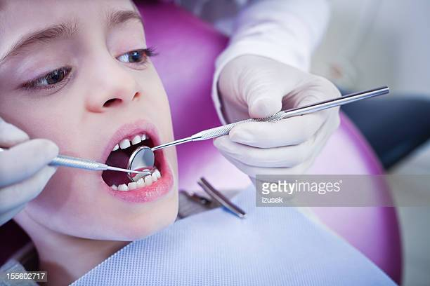 Young Boy Dental Patient Getting Examination