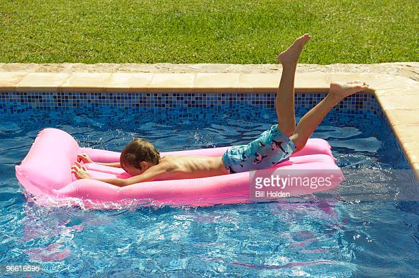 A young boy diving on to an inflatable