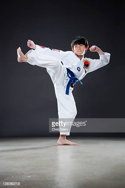 Young boy doing a karate side kcik