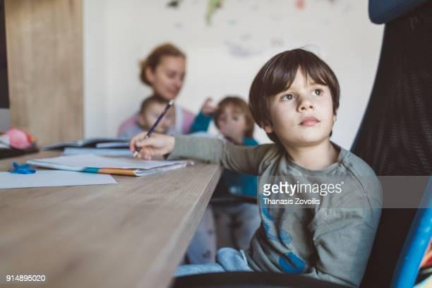 Young boy doing his school homework