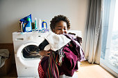 Young boy doing housework at home