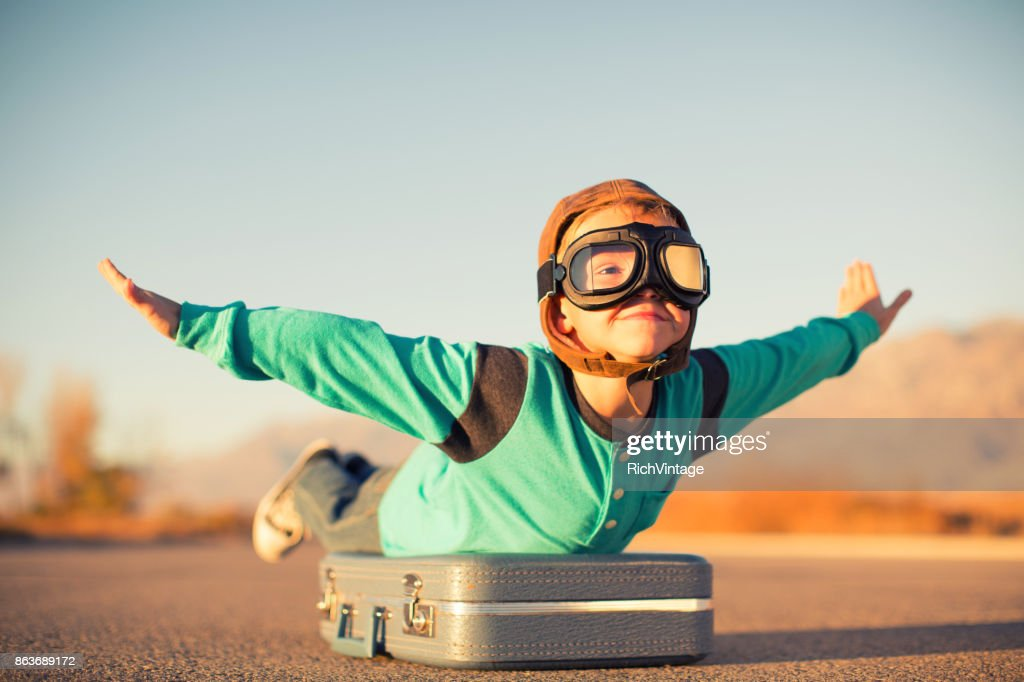 Young Boy Dreams of Air Travel : Stock Photo