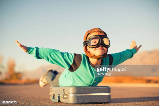 young boy dreams of air travel - escapism stock photos and pictures