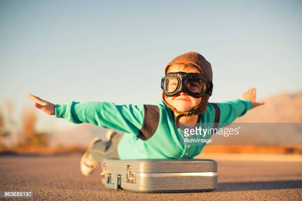 young boy dreams of air travel - flying goggles stock pictures, royalty-free photos & images