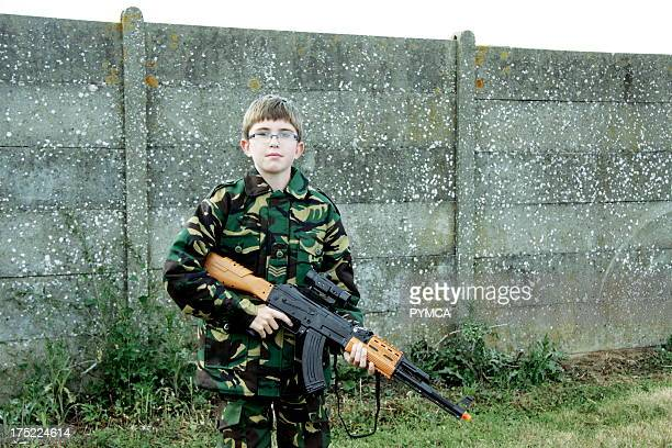 Young boy dressed as a British soldier at a battle reenactment day in Kent