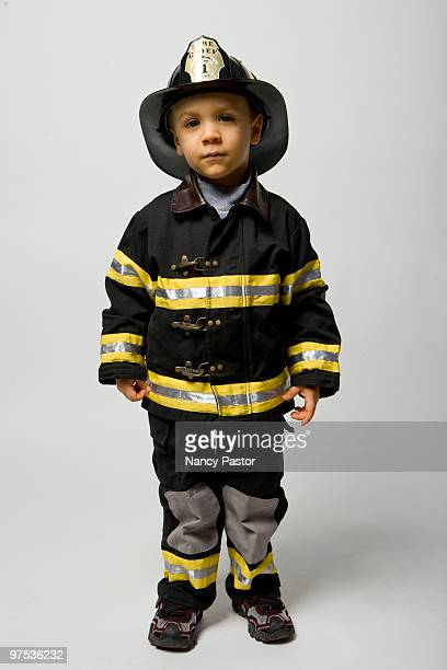 Young boy dressed as a fireman for Halloween.