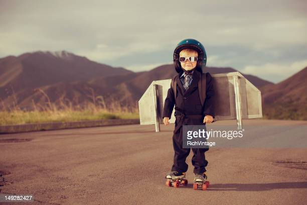 Young Boy Dressed as Businessman Wearing Jet Pack