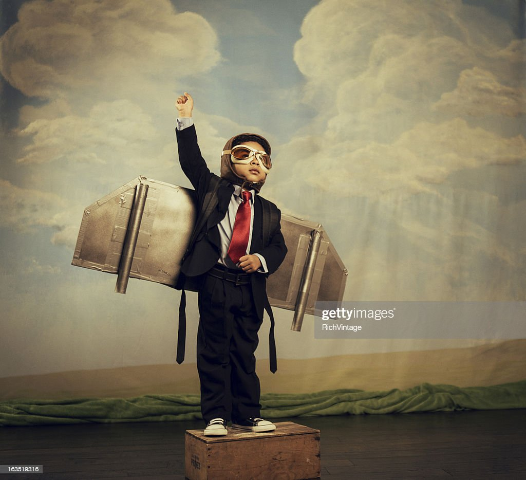 Young Boy dressed as Businessman Wearing Jet Pack : Stock Photo