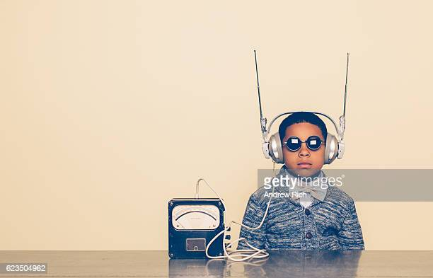young boy dressed as nerd with alien headphones - luisteren stockfoto's en -beelden
