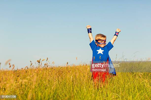 Young Boy Dressed as Superhero Imagines Flying