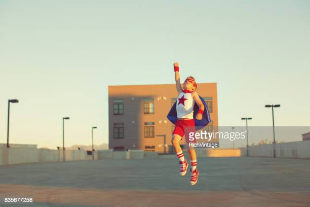 Young Boy Dressed as Superhero Jumps to the Sky