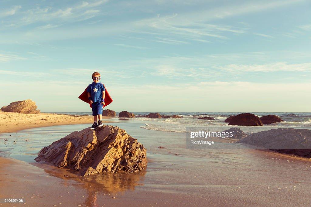 Young Boy dressed as Superhero on California Beach : Stock Photo