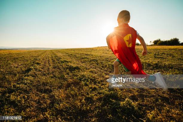 young boy dressed as superhero - superhero stock pictures, royalty-free photos & images