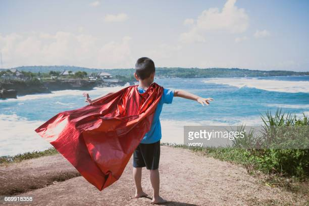 young boy dressed as superhero - cape garment stock photos and pictures