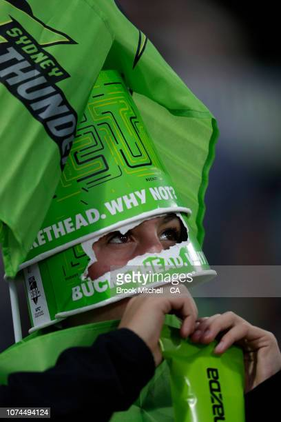 A young boy dressed in a bucket hat shows his support during the Sydney Thunder v Melbourne Stars Big Bash League Match at Manuka Oval on December 21...