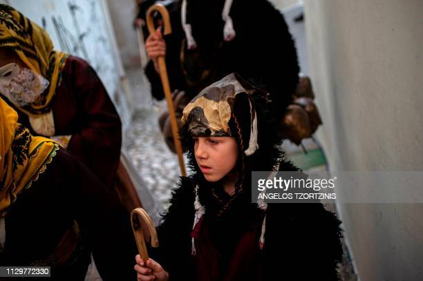 A young boy dressed in a costume of ''Old man'' takes part in the Skyrian Carnival on the island of Skyros northeast of Athens on March 9 2019 In the...