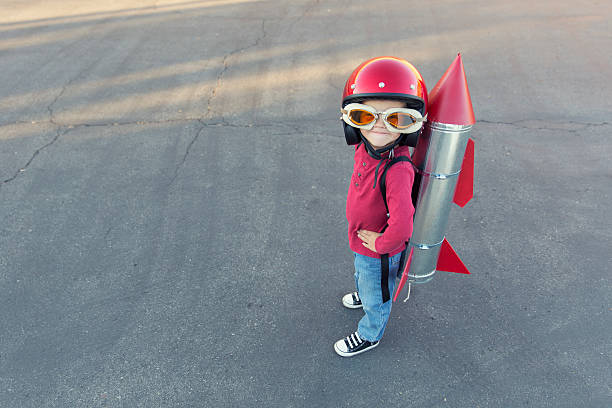 Young Boy Dressed In A Red Rocket Suit On Blacktop Wall Art