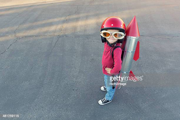 young boy dressed in a red rocket suit on blacktop - perfection stock pictures, royalty-free photos & images